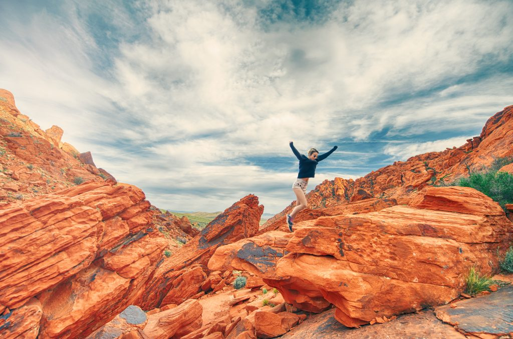 Women climbing mountain